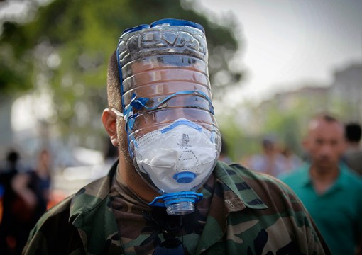 A man wears a make-shift gas mask hours in Istanbul, Turkey